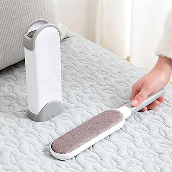 Dust and hair removal brush with cleaning stand